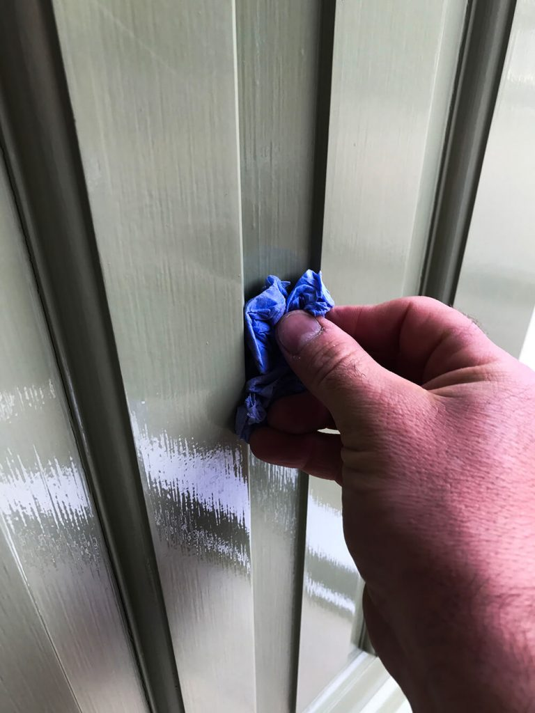 Cleaning out cracks around door panels