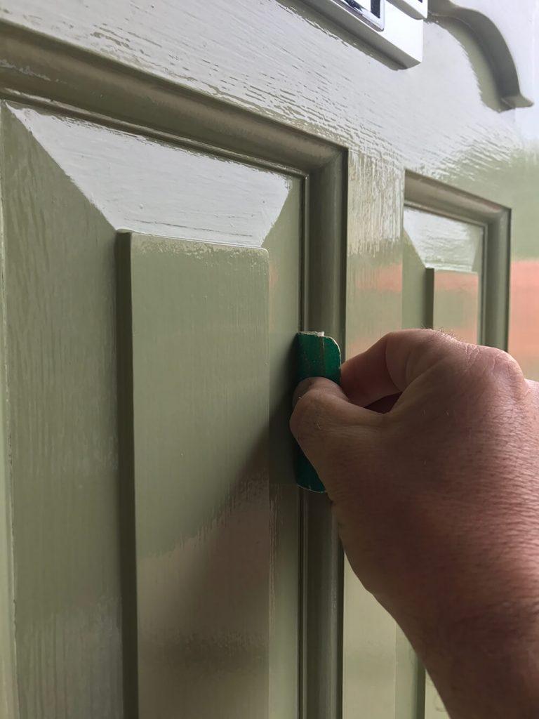 Sanding cracks around door panels