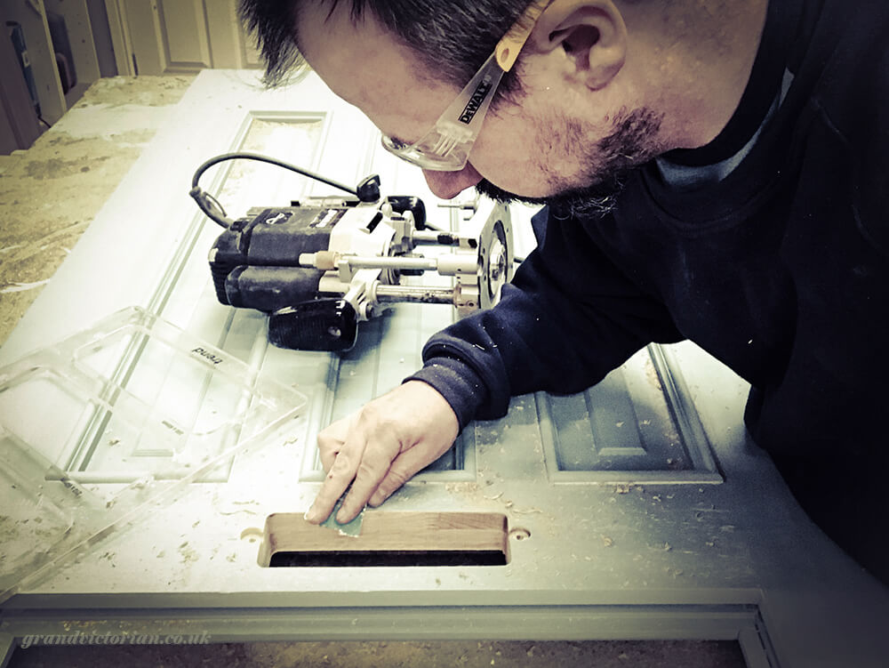 Cutting a hole for a letter plate in a door