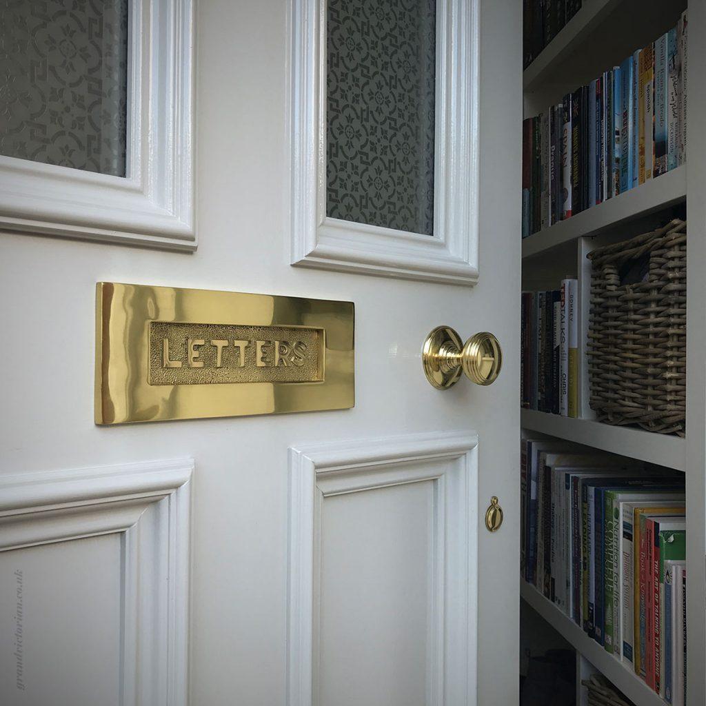 Brass door furniture on a Victorian front door in Hale