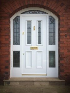 Maggie's Victorian front door and arched frame in Lostock 159-BL6-4EP