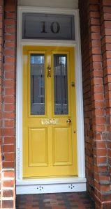 Yellow front door in Stretford