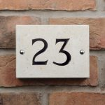 Hand crafted limestone house number