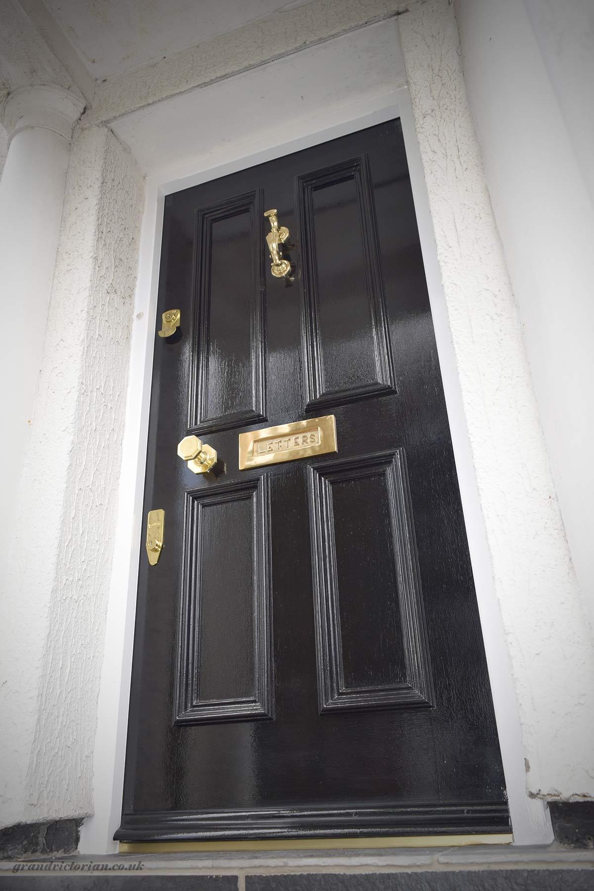 Black Victorian front door with brass furniture